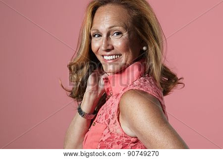 Happy Smiling Senior Woman In A Pink Background