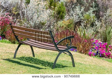 Rustic Bench Between Flowers