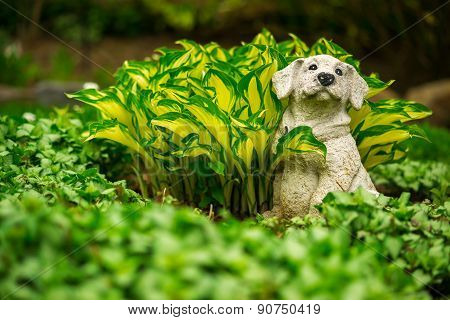Cute Happy Dog Lawn Ornament In Lush Green Garden