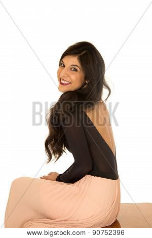 Pretty Brunette Female Model Sitting Smiling Side View