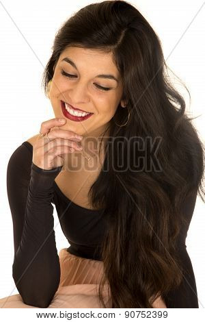 Pretty Brunette Female Sitting Smiling Hand On Chin Looking Down