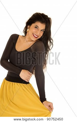 Pretty Young Woman Wearing A Black Top And Yellow Skirt