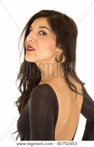 Pretty Woman Wearing Tight Top With Bare Back Looking Backwards Over Her Shoulder
