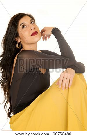 Beautiful Brunette Woman Sitting Wearing Yellow Skirt Looking Up