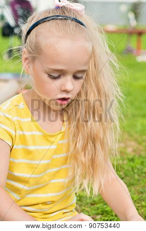 Portrait of beautiful playing little girl
