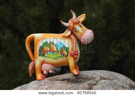 Cheerful Cow On A Stone