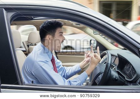 Angry Man Showing Middle Finger In Car