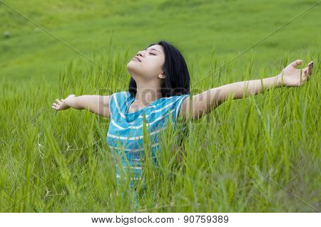 Attractive Woman Enjoying Freedom In Nature