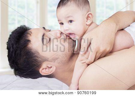 Happy Dad Kiss His Toddler