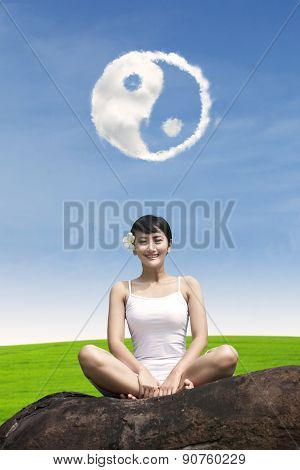 Happy girl under ying yang cloud outdoor