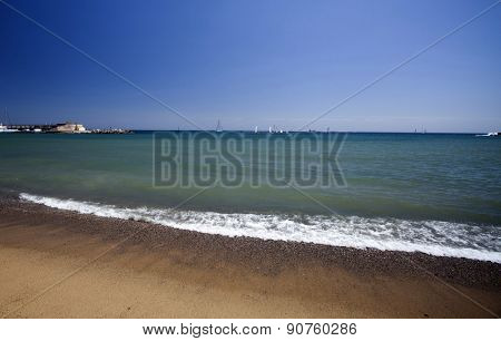 BARCELONA, SPAIN - MAY 5: Barceloneta Beach in May5, 2013 in Barcelona, Spain.  Barceloneta is a neighborhood in the Ciutat Vella district of Barcelona in front of the mediterranean sea.