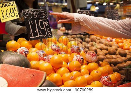 BARCELONA, SPAIN - MAY 4, 2015: Famous La Boqueria market - one of the oldest markets (Established in 1217) in Europe that still exist. Close up on a huge selection of fruits.