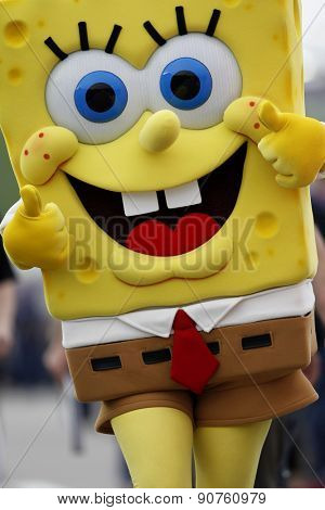 Kansas City, KS - May 09, 2015:  SpongeBob SquarePants walks down pit road before the start of the SpongeBob SquarePants 400 at Kansas Speedway in Kansas City, KS.