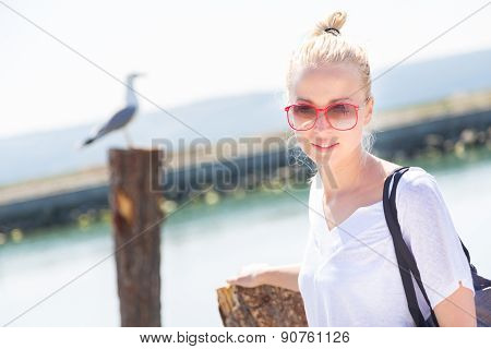 Woman on the beach in summertime.