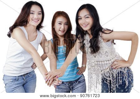 Pretty Teen Students Joining Hands
