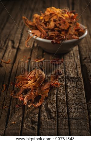 Myristica fragrans against wooden background