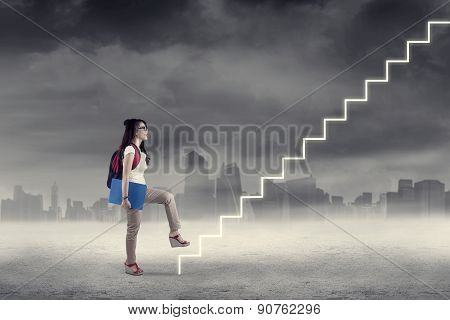 Student Stepping Upward On The Stairway