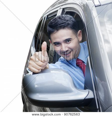 Successful Man Showing Thumb Up In Car