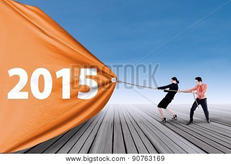 Two People Pulling Number Of 2015