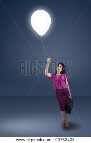 Woman Pulling A Bright Balloon