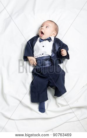 Cute baby boy wearing an elegant suit with bow tie