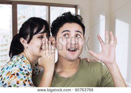 Woman Whispering A News To Her Boyfriend