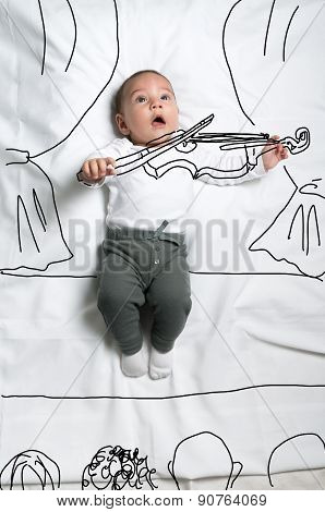 Cute baby boy decorated as a violinist performing