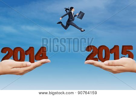 Young Entrepreneur Jumps Above A Slit