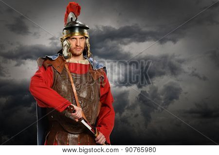 Portrait of Roman soldier with sword over stormy sky