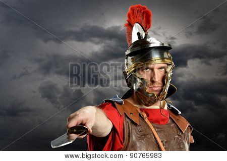 Portrait of Roman soldier brandishing sword over dark clouds