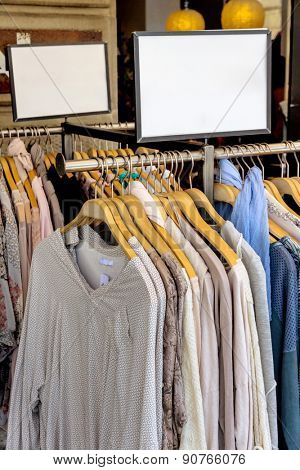 Clothing racks in a shop.