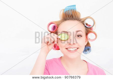 Young girl with curlers on her hair