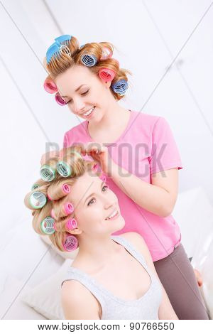 Happy friends making hairstyle
