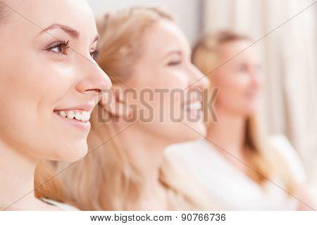 Beautiful girls sitting in a row