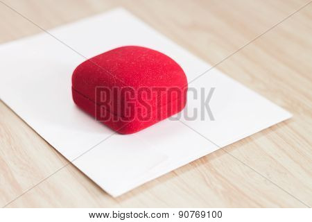 Red Ring Box On Wooden Background