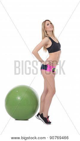 Flirtatious fitness girl posing at camera
