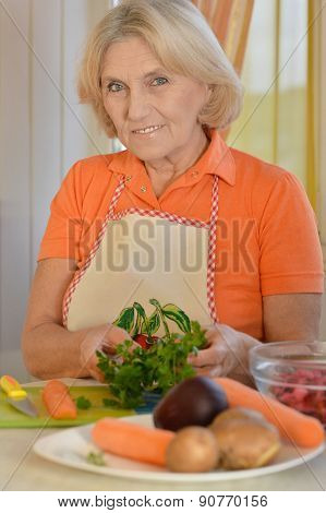 Cute elderly woman preparing
