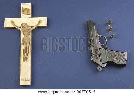 wooden crucifix with the lettering INRI and gun
