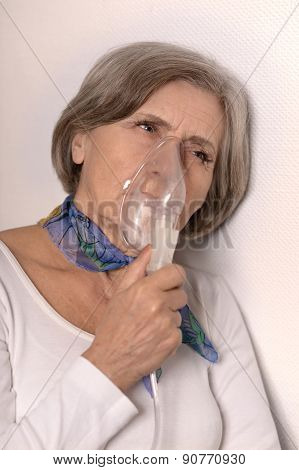senior woman with inhaler close-up