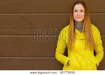 Beautiful fashionable girl in jacket of a wall