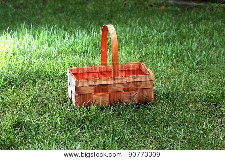Straw basket in green grass