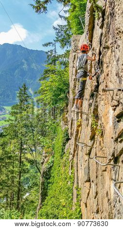 Young woman climber on via ferrata, Alps, Austria
