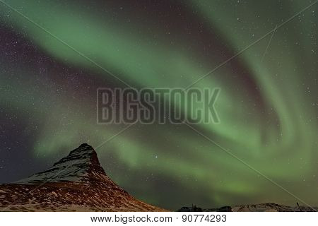 Northern Lights And Satellite Trail Over Kirkjufell Mountain