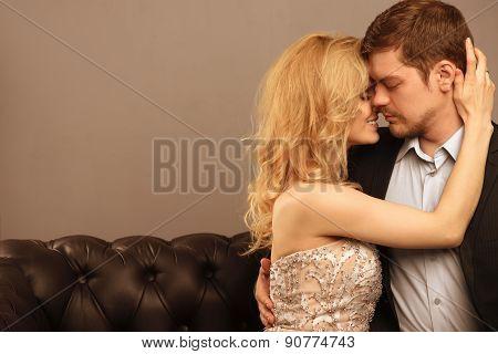 Luxury couple at sofa