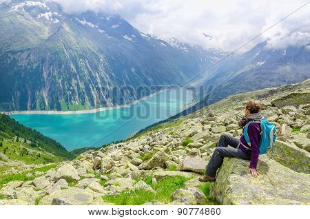 Beautiful alpine landscape and young woman Austria