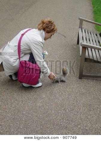 Woman Feeding Squirrel