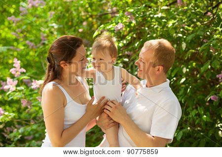 Family With Baby Boy Outdoors