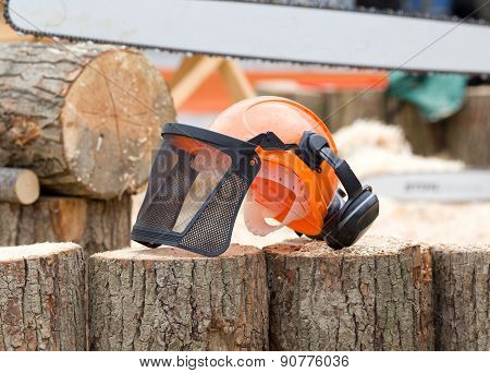 Helmet With Mask On Wooden Logs