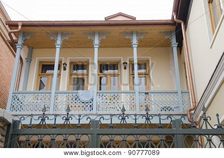 Blue carved wooden balcony. Tbilisi, Old Town