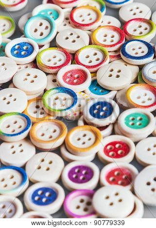 Multi Colored Buttons Wooden Background